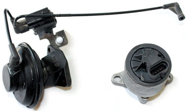 The EGR valves used with the Gen III PCM are unlike the early vacuumoperated EGR valves. The LT1 EGR valve (left) opens when vacuum is applied through the electrical solenoid. (Notice the vacuum lines from the solenoid to the engine and from the solenoid to the EGR valve assembly.) Newer engines use an electronically controlled EGR valve (right) with an internal sensor. Early engines being converted for Gen III PCM use either need a custom EGR solution or the elimination of the EGR valve.