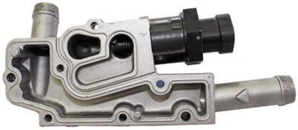 With the IAC housing removed from the bottom of the throttle body assembly, you can see the IAC passage. The pintle, attached to the electronic valve, is moved in one direction or the other to allow engine vacuum to pull air through the IAC passage. Sometimes this passage is dirty with carbon buildup and must be cleaned to restore proper function. The passage at the bottom here is for engine coolant. The warm coolant temperature keeps the throttle body from sticking in very cold weather conditions, but General Motors ultimately eliminated the coolant passage in newer throttle bodies.