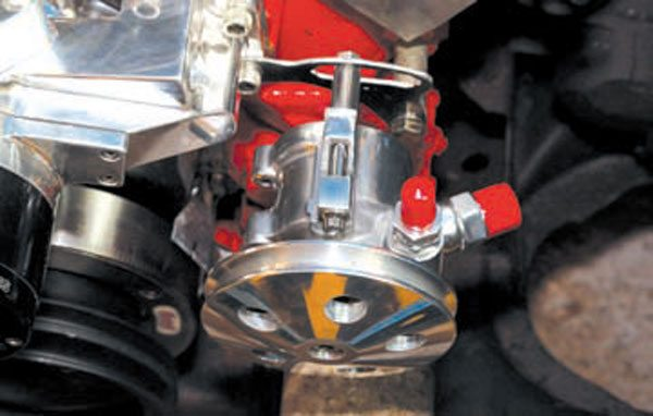Sometimes a power steering pump with a built-in reservoir is too large to accommodate a particular swap. A Summit Racing GM Type-II mini-pump is a viable option because it is considerably smaller than the reservoir pumps, although it does require a remote reservoir.