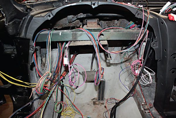 Inside the car, the bundles of wire were split into groups and routed to their locations. Don't cut any wire until the entire harness has been routed.