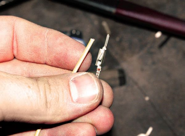 The terminals must be crimped twice, once on the bare wire and once on the silicone insulation. Make sure you slide the wire through the silicone boot before crimping.