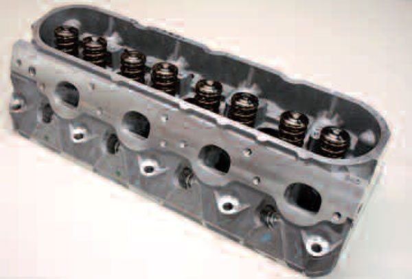 "A wide variety of LS cylinder head porting shops are out there. Some will port your own castings, while others will send you already-ported units and have you return your used heads for a core charge refund, saving you turnaround time. Here's an assembled head from Patriot Performance, a popular source. You can tell this one is a GM casting from the ""243"" in the lower right hand corner, meaning it's an LS6/LS2 casting."