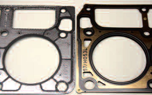 Although they seal decently well, the earlier-style graphite-layered steel core head gasket (left) should normally be avoided in favor of the more advanced MLS design (right). The main concern is the mess the earlier type of gasket will make should a cylinder head ever need to be removed for service or upgrade. This earlier type gasket must be used, however, with some early-style Gen III heads that had a recessed area along the outer edge of the deck surface (see Chapter 8), as the newer style gaskets will not seal properly with these heads. Both of the gaskets shown were manufactured by GM.