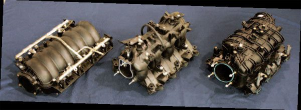 A large variety of intake manifolds were installed on Gen III/IV engines. Cross-compatibility issues arise in cable- versus electronic-throttle provisions, not to mention exterior manifold dimensions possibly interfering with installation into a given vehicle. Here we see, from left to right, an LS2 car intake (electronic), LQ9 truck intake (cable), and L76 truck intake (electronic). Some engines had a different style intake depending on the vehicle they were installed in. For example, LS2s installed in trucks had taller truck-style intakes. (Note that an LS9 or LSA has a supercharger in place of the intake manifold.)