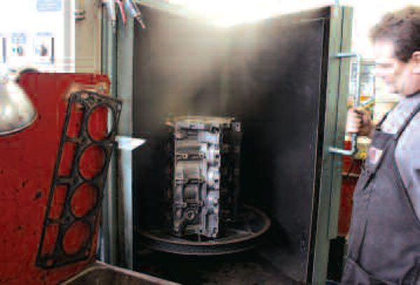 As a used block is normally caked with sludge and grime, it will need to be cleaned before a thorough inspection and evaluation can take place. One option is this so-called jet wash cabinet, which blasts the block with a non-caustic, biodegradable alkali solution for 15 minutes at temperatures between 180 and 190 degrees F. This type of machine is commonly used to clean other engine parts as well. We should note that caustic cleaning solutions will harm aluminum and may only be used on iron blocks (iron blocks can also be soaked in a so-called hot tank if particularly dirty).