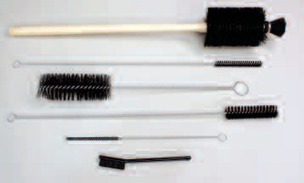 A typical engine brush kit. The nylon bristles won't scratch metal surfaces, and their long handles will enable you to scrub oil galleries spanning the length of the entire block.  This particular one lacks a large enough bore brush, though one isn't essential for the job (bores are better cleaned with towels anyway).