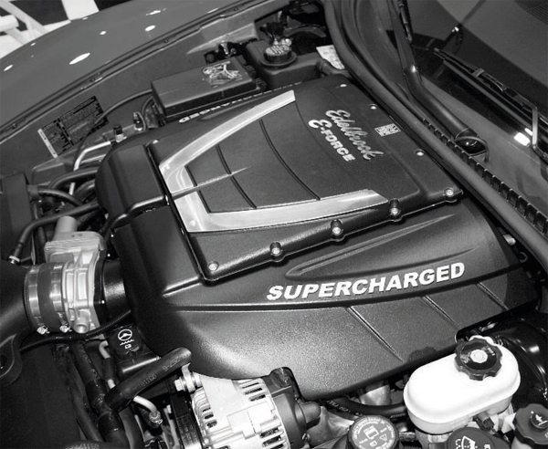 In late 2009, Edelbrock introduced a new, OEM-style supercharger system for a number of LS2- and LS3-powered C6 Corvettes and the 2010+ Camaro SS. Carrying the E-Force brand name, Edelbrock's supercharger kits use Eaton's four-rotor, 2.3-liter TVS compressor at their cores. Like the factory LSA and LS9 engines, the E-Force systems feature air-to-water intercooling systems with dual brickstyle heat exchangers mounted on top of the supercharger assembly. Design features of the E-Force system include a front-driven compressor and long, 12-inch intake runners that optimize low-RPM torque. For C6 Corvette owners, the advantage of the E-Force kit is that it mounts under the stock hood. Currently, the popular Magna Charger kit requires a replacement or modified stock hood with increased clearance.