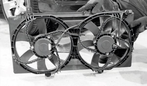 """Generally speaking, the factory electric cooling fans and radiator of most LS-powered vehicles are adequate for most bolt-on blower and turbo kits of low- to moderate-boost levels. However, the variable fan controller found on LS3-powered C6 Corvettes is a popular conversion for those factory fan systems, as it allows the fan speed to be """"tuned"""" through the engine controller software to optimize the speed."""