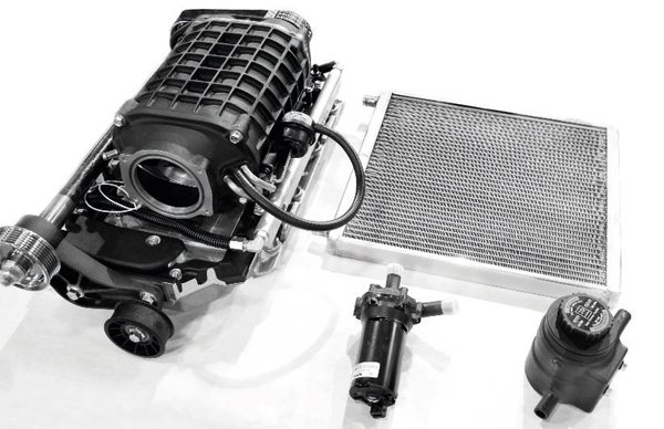 "The Eaton-based Magna Charger supercharger system is delivered ready to bolt on. In fact, the 1.9-liter supercharger was pre-mounted to the intake manifold, as seen here. The satin-black finish looks more ""O.E."" than the typical baremetal finish of most blowers. The other primary components of the system include the heat exchanger, electric pump, and coolant reservoir for the charge-cooling system. It is a dedicated system, meaning it is separate from the engine's cooling system and maintains its own circuit of coolant (the same 50/50 mix of water and coolant typically used in engines)."