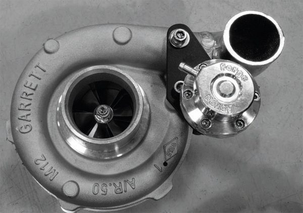Lingenfelter's basic system uses a pair of mid-size Garrett GT30-series water-cooled, oil-fed ball bearing turbochargers and Forge wastegates. The medium-size bodies of the turbos make them ideal for easier fitment and quick spool-up. The A/R ratio, as noted on the casting seen here, is .50:1.