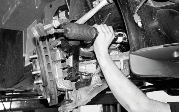 The placement of the steering rack on C5/C6 Corvettes generally requires its removal for the pinning procedure. It is easily unbolted and pulled out of the way, but extreme care must be taken to ensure the steering wheel is pointed straight ahead and held there during the removal process. This can be done by running masking tape (or other low-residue tape) between the top of the steering wheel and dashboard. After the steering rack is unbolted, the individual spindles can be moved, but they must be returned to the original position when the rack is re-installed. A sensor in the steering system detects whether the rack and wheel are aligned; if they are not, drivability may suffer and a trouble code is triggered on the driver information center. The steering wheel should not be touched while the steering rack is unbolted and/or removed.