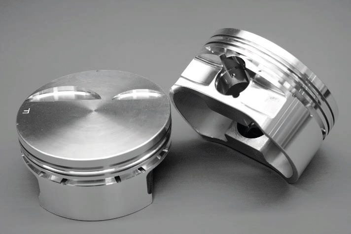 Here is a common, forged-aluminum piston design for LS engines. The flattop design, however, is not conducive to optimal forced-induction performance, as it would likely deliver too high of a compression ratio. Excessive compression can lead to enginedamaging detonation under boost.