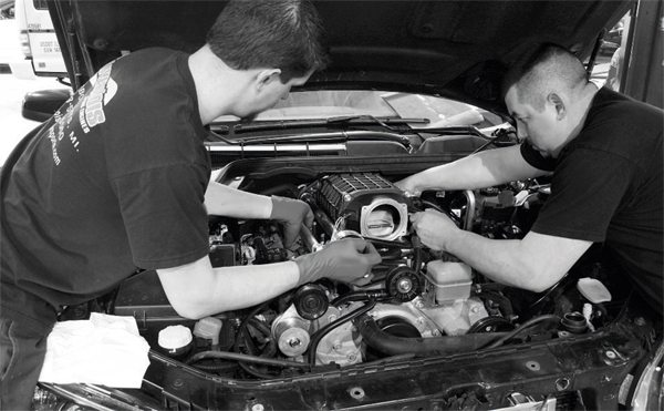 At last, the supercharger/ manifold assembly is carefully lowered onto the engine. Because of the weight and awkward size of the assembly, it is a two-person task. On some vehicles, a replacement valley cover (including the transfer of the oil-pressure sensor) is required and included with the kit, but that was not the case with this G8 application. Also, some vehicles may require the removal or relocation of a factory engine-installation bracket or, on vehicles with an automatic transmission, the relocation of the automatic transmission fill tube. Again, this was not the case with the G8. Once the assembly is in place, the manifold bolts are tightened to the manufacturer's recommended torque specification.