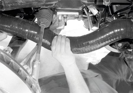 The silicone hoses are carefully routed from the turbochargers along the chassis rails, with numerous checks and inspections to ensure they don't bind or interfere with the suspension and steering systems.