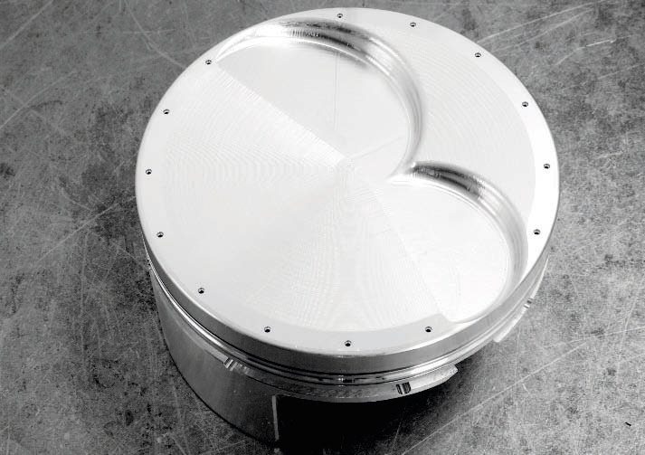 Here's an example of a gas-ported piston intended for drag racing, you can tell it by the the holes drilled through the piston head. Because those tiny holes can get clogged with carbon over even a relatively short period of operating time, gas porting is not an effective idea for street engines. The pressure created on the cylinder rings also wears them out much faster, requiring frequent replacement.
