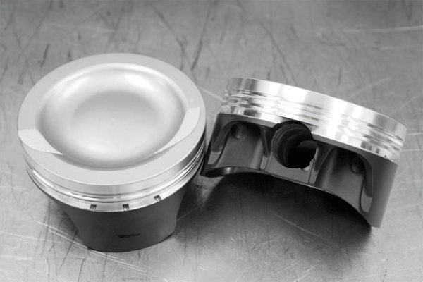 The LS7's cast-aluminum pistons were replaced not so much for concern of their strength under boost, but because they delivered too much squeeze, at 11.0:1 compression. Forged-aluminum, coated pistons from Diamond were used. They are dished to lower the compression ratio to a detonation-avoiding 9.0:1. The blower-specific pistons also have a thick surface crown and reinforced pin bosses. Forged I-beam rods (in the stock, 6.067-inch length) from Oliver were used in place of the LS7's titanium rods. The lightweight titanium rods simply weren't designed for the load and power levels expected of this engine. The effect of greater mass on the rotating assembly with heavier I-beams will be quickly offset with the rise in boost pressure under load.