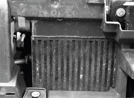 The other major component of the turbo system is the intercooler, which includes a custom heat exchanger built by Stenod Performance. It's an air-to-air intercooling system, meaning the pressurized air from the turbo system simply flows through the exchanger and is cooled by air entering through the grille or from the electric cooling fans. There is no liquid coolant circulating in the heat exchanger, as would be the case with a liquid-to-air intercooler. Stenod started with a Bell core and built the inlet/outlet caps to fit the TrailBlazer. It mounts to a removable header that's part of the TrailBlazer's radiator core support, making installation and removal very simple.