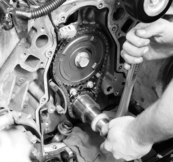 With the timing gear correctly aligned, the cam gear is unbolted and removed. The crankshaft sprocket remains installed on the engine.