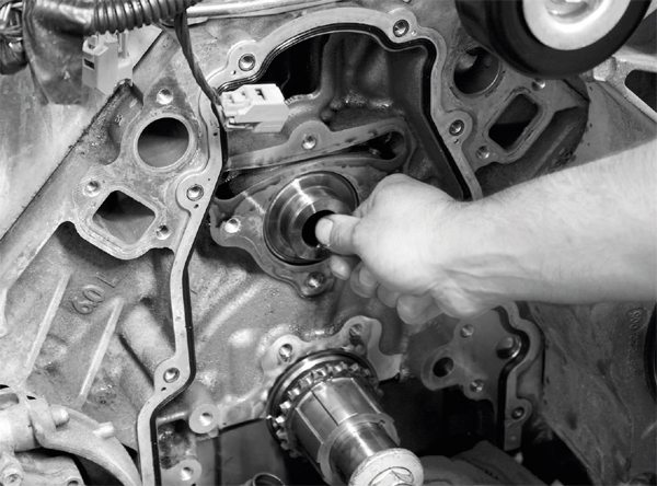 """Before the stock camshaft is pulled out of the engine, it must be rotated a few times while still in its bore. Doing so pushes the lifters into a """"locked"""" position that enables the camshaft to be removed without the lifters falling into the engine."""