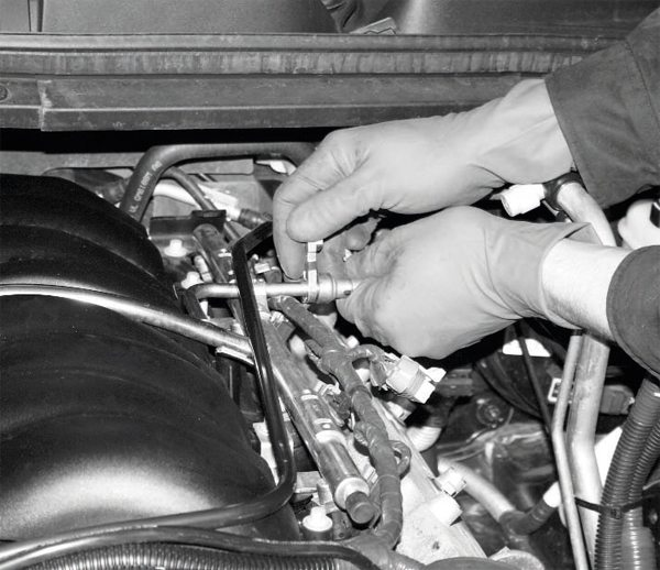 After properly relieving the fuel pressure (see Chapter 4), the fuel system is disconnected from the fuel rail in preparation for the intake manifold's removal. Fortunately, the Magna Charger kit comes with a fuelline disconnection tool, but you should check the kit's contents for it prior to starting the installation. If the supercharger kit does not include the tool, you should obtain the correct one before starting the project.