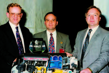 "The Gen III V-8 engine was voted Wards' Engine of the Year in 1997 and Ed Koerner (right) accepted on behalf of the entire Gen III V-8 team. That a ""new"" pushrod engine won this award was almost unbelievable to the design team."