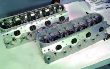 Famed GM cylinder head designer, Ron Sperry, developed the original Gen III V-8 heads (foreground). Ken Sperry's team developed the ports and combustion chamber. The Sperrys have been called on for input into just about any important production or racing GM port and chamber design over at leat the last 20 years – like the C5R Gen III racing head in the background. For the Gen III, they used every capability GM has: supercomputer flow modeling, prototype component construction, hydra single- cylinder test engines, flow benches, and dynamometers.