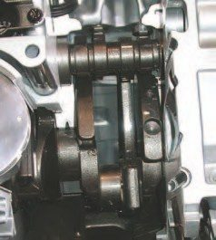 This cutaway of a Gen III engine shows how compact and busy the rotating and reciprocatingcomponent area is. To get everything tight, GM engineers did things like have the cast crank counterweights cam-ground to clear the bottoms of the pistons. The powdered-metal rods and eutectic-aluminum pistons were chosen because they have good durability, performance, and piece cost for their size and weight.