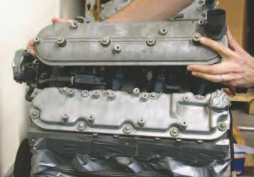 If you're looking at a Gen III V-8 with bolts around the perimeter of the valve cover, it's a 1997-98 model. The Gen III engine design was originally proposed with a center-bolt design, but the design wasn't fully validated for the 1997 launch. Since the perimeter design was well known from previous small blocks, it was implemented instead. The 1999 and later center-bolt valve covers and heads are more desirable for other features that improve their performance and durability.