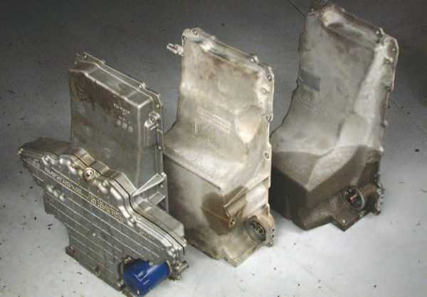 "One of the biggest development snafus and manufacturing challenges was the ""batwing"" oil pan for the Corvettes (left). The oiling issues were resolved before going to production, but the shallow pan made oil control a challenge. The first batwing pan was a single casting that was very difficult to manufacture. In 1998, a two-piece batwing pan was introduced. Both pans perform well under the most extreme conditions. The Camaro and Firebird oil pans (middle) are called rear sump because the deep portion of the oil pan is towards the rear of the engine. Since the oil pump is at the front of the engine, a long pickup winds its way from the lowest point of the oil pan up to the pump. This pan is often used when a Gen III is installed in a past model vehicle — but often the first two inches of the pan hits the crossmember, so either the oil pan or crossmember needs to be trimmed to fit. The Camaro windage tray does not run to the front of the engine, like on the Corvette or truck pans, since the oil pan is very close to the crank at the front of the engine. The truck oil pan (right) has a deep sump, which is good for oil capacity and power production, but it's difficult to package on cars with low hoods and low ground clearance."