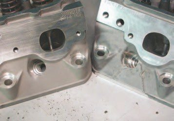 Many of the road racers look for the LS6 heads with these triangles under the exhaust port between the headbolt bosses on the side of the cylinder heads. Many racers claim these are good for a 6-to-10-hp lift over the heads that otherwise look identical. The horsepower improvement are due to casting-core differences between sand casting (left) and semi-permament mold (SPM) casting (right), but we aren't able to see any differences.