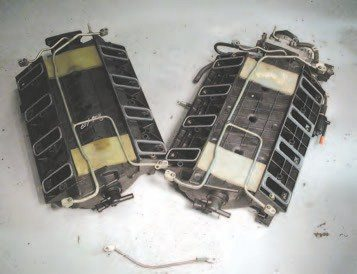 """Another way to identify the LS6-type intake (right) is by looking underneath it. The LS6 intake has a flat floor, while the LS1 style intake has a lot of shape, with a single hump down the length of the intake. Also, the LS6-and-later intakes have the square ribbing between their intake ports, while the early intakes have large """"x"""" ribbing."""