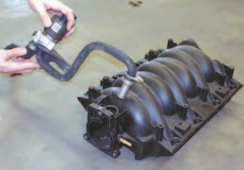 By the time the LS6 came out, the GM Engineers improved the calibration of the engines and eliminated the AIR system inlet into the intake manifold. Because of this, hot-rodders can delete this system when upgrading to the LS6 intake. Use GM PN 12558346 to plug the hole in the intake.