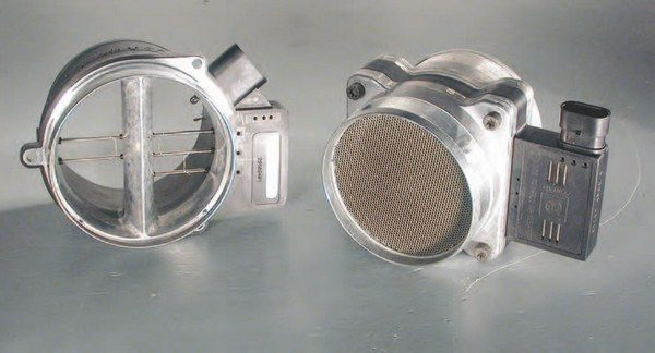 The MAF on the left is from an LS6 engine, while the MAF on the right is from a 5.3-liter truck engine. The LS6 MAF screen is easily popped out, but the truck MAF has a lock ring that must be removed before the screen can be popped out.