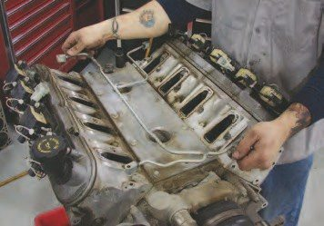 6. Early Gen III V-8s came with this tubing apparatus to vent any steam pockets in the cooling system from both the front and rear. The LS6 intake (which became standard on both the LS1 and LS6 in 2002 and beyond) has more drop in it for a larger plenum area, so GM eliminated the tubing under the intake. To make this work, the rear vent holes are blocked off and the front steam vents are tied together with a tube (the front ties into the throttle preheat system). To remove the vent tubing, loosen the four 6-mm bolts with a 10-mm hexhead socket.