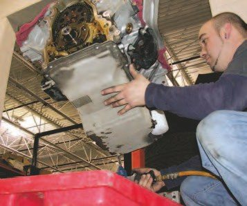 14. There are ten 10-mm hex-head, 8- mm diameter bolts to be removed from the main portion of the oil pan, and two 10-mm hex-head, 6-mm diameter bolts at each end of the oil pan that bolt to the front and rear covers. You need to remove them all to get the oil pan off the engine. The oil pan is a stressed member on the Gen III V-8, but it doesn't use dowel pins or any other type of locator, so the installation process requires some detail to get the front and rear covers and oil pan to all find their homes.