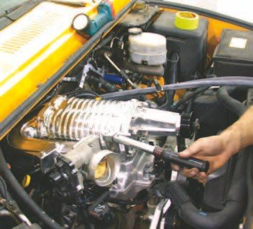 Pull the protective tape off the intake ports just before you install the supercharger and intake manifold combo. Always make sure nothing falls down into these ports as it will cause terrible damage to the engine.