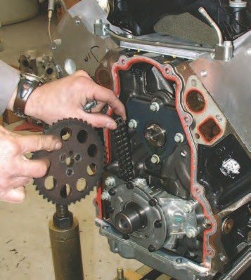 7. Next you'll need to remove the upper timing gear from the cam and set the chain off to the side.