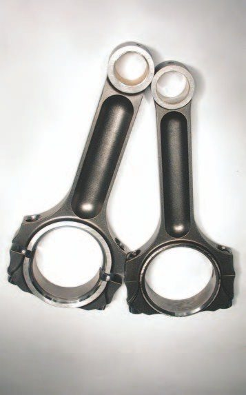 15. Here is a great comparison shot of a stock Gen III V-8 connecting rod on the right of the Oliver billet steel rod. With the difference in size, it's easy to see why there is so much mallory in the crank.