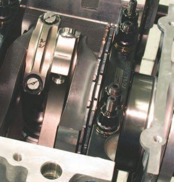 """17. The rod bearing clearances are attained by measuring each crank rod journal and the ID of the appropriate connecting rod in the multiple positions as on the crank main bearing setup (twelve-to-six and three-to-nine o'clock). For more on this, see page 106. Again, using various bearing shell combos helps to get the proper clearance. Once these numbers have been determined, the engine is tightly """"bagged"""" with a plastic bag, to prevent dust and dirt from adhering to the inside of the engine."""