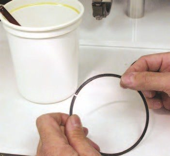 """4. Before installing the pistons, W2W wipes the face of the top and second rings with a light coat of 30-weight oil dripped on the fingers. They then wipe the rings with a non-linting towel before installation. Using a light brush, the oil ring lands are lightly covered with 30-weight oil, and then wiped with a non-linting towel to remove any excess oil. You need to remove the excess oil to prevent it from """"cooking"""" into the ring lands upon startup, which could prevent the rings from sealing properly."""