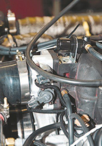 The throttle body is just as stock as the rest of the build; it's the 75-mm stock factory piece with a stock LS1 intake