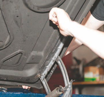 All you do is remove four bolts and have an extra pair of hands to help take off the hood.