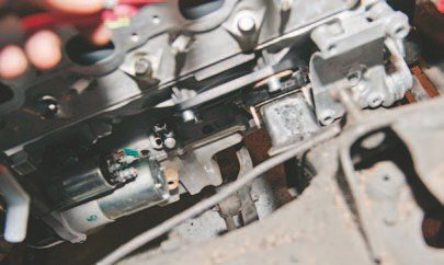 "Many companies offer a suitable oil pan for many LS swap projects. These include Holley, Mast, GM Performance, and other reputable places. You need to consider the placement of the K-member, steering components, and engine. Specifically, the engine is often placed far back in the chassis. I have yet to find any engine mounts that fit well more forward than the stock or ""0"" location. Moving it back toward the firewall is quite easy, as LS engines do not have a distributor to get in the way. Dirty Dingo adjustable mounting plates are suitable for this type of engine positioning"