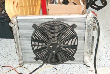 The old direct-fit aluminum radiator and SPAL fan combination was used to cool the old small-block. It worked just fine and would probably work with the new Mast LS3. However, I upgraded the entire car and I needed to ensure the engine had excellent cooling so the engine could run at its best and not overheat. Besides, I wanted to run the A/C and I didn't think the old system could handle the cooling requirements.