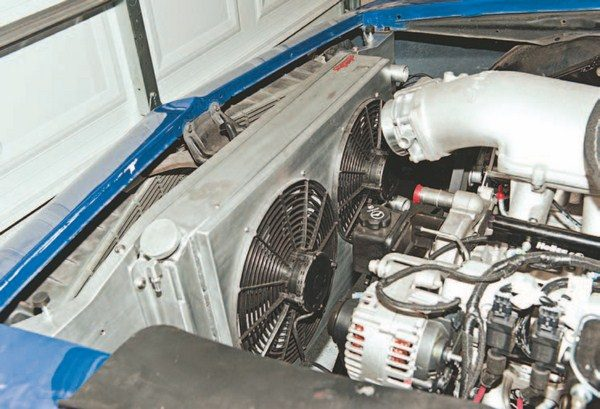 The radiator and fan combo has been installed just like the stock one would have been (with two on each side of the radiator). The supplied catch can for the radiator mounts on the cap side with the same two bolts that hold it in place. The fans came with a premade wiring harness. Because the Mast harness comes with wires for electric fans (much like the stock ECM), hook up was a breeze by simply splicing the ECM wires into the fan harness