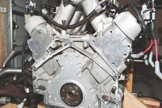 The back of the LS engine is different in two major ways. First, it doesn't have the familiar 1 o'clock position bolt, and second, it's .400 inch from the back of the engine to the flange that mates the transmission to the engine.