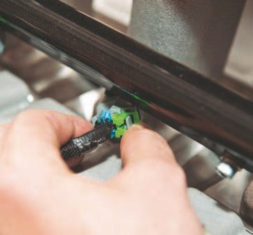 The injectors and some of the other connectors have a different way of locking. You need to figure out the type of retention system and clip that needs to be pulled. In this case, the green clip needs to be pulled before the plug can be removed.