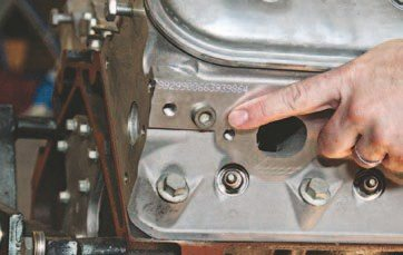 am pointing at the water plug that can be used for virtually anything to do with the coolant. This hole measures M12 x 1.5. If you're looking for an adapter, it needs to be this size. Most gauges do not fit this size and need an adapter. Mechanical gauges are usually too big for the adapters, so you have to run an electric gauge or figure something else out. If you're going this far to put an LS engine in your car, don't scrimp on the gauges, they are cheap insurance. (Photo Courtesy Auto Meter)