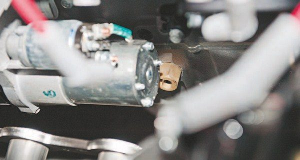 The brown port behind the starter is the oil level sensor. Removing it with a socket or wrench allows the adapter to monitor the oil temperature.