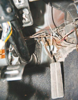To remove the original gas pedal, remove the two bolts holding the pivot arm in place. A simple socket does the job even though it can be a bit of a pain and the plastic holder can easily break. Remove the cable from the pedal and it should fall right out after removing the bolts located on the firewall that hold the pedal lever in place.